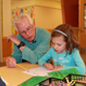Volunteer helping a student with reading